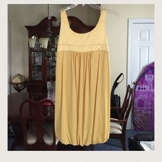 NWT BeBe mini dress great for going out partying Brand-new BeBe mini dress. With a elastic band on the bottom. The color is called Goldenrod. This is a great party dress.  Serious offers only. Please use the offer option button. bebe Dresses
