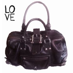 Ellen Tracy Black Leather It Girl Bag This is an awesome bag. Leather with silver hardware. Handles are dark black but have a little wear that's not very noticeable. I will post a close up of the handles. Comes with cloth storage bag. Ellen Tracy Bags Satchels
