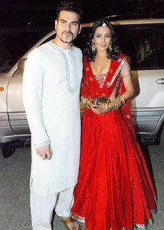 Lovely dressed couple! Mallaika Arora Khan is looking gorgeous in her Red lehenga! http://www.shaadiekhas.com/