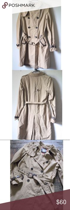 Vince Camuto Women's Trench Coat Vince Camuto Women's Trench Coat. Size medium. No rips or stains. Only flaw is the belt on the left wrist is torn at the tip (as can be seen in picture). Has shoulder pads. Vince Camuto Jackets & Coats Trench Coats