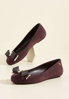 $105 Indulge in a most stylish ensemble component by adding these vegan flats to your look! Created in a rich purple hue, finessed with gold-touched bows at the toes, and finished with luxe flocking, this 100% recyclable pair from Melissa Shoes allows you to step out in intricate style.
