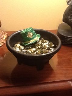 Coated  rocks with glue then shook them in a ziploc with gold glitter