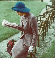 Model is wearing a grey suit with a blue hat and holding an umbrella, 1947. #hat #vintage #fashion #1940s