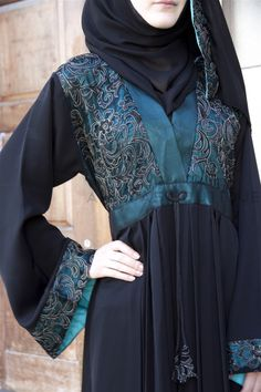 Empress Emerald Gem Abaya Empress Emerald Gem Lace Abaya is absolutely exquisite with an abundance of rich green regal embroidery lace over green satin on bodice and with satin trimmings Empress Collection ABAYAS-Abayas Boutique