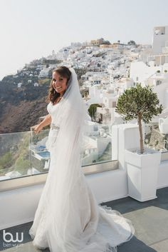 kirsty and jacks romantic sunset view terrace wedding in santorini by the bridal consultant