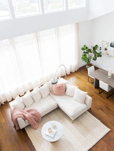 MARIANNA HEWITT HOME TOUR | LIVING ROOM   SECTIONAL COUCH   CHUNKY KNIT  BLANKET   MARBLE