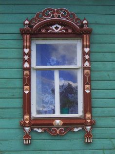 Russian window  love exterior color.  cute with yellow trim