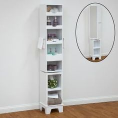 Gallery One Rotating tall bathroom cabinets from Dwell feature a mirror and mirrored glass
