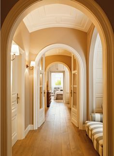I love the arched doorways down this hall! Though I'd choose a different color myself. Gray perhaps?