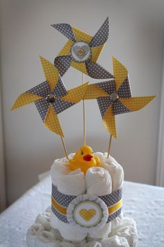 Diaper Cake. grey and yellow baby shower | Materials to make the handmade yellow and grey baby shower decor: