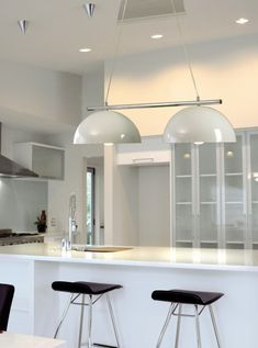 Ideal for over kitchen islands, dining tables and pool tables. Their simple design and colour finish make them versatile options for a range of different backdrops. The Retro Modern range comes in two colour variations: Either a high gloss black paint finish with a matt white inside, or a high gloss white paint finish with a matt silver inside.  #Lighting #LightingNZ #LightingTrends #HomeRenovation #nzdesign #lightinginspo #lightingideas #lightinginspiration #homedecor  #led #ledlighting Modern Pendant Light, Pendant Lighting, Globe Lamps, Ceiling Rose, Home Renovation, Light Colors, Simple Designs, Pool Tables, Dining Tables