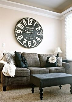 Love the sofa and black and white pillows.