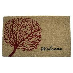 """Coir doormat with a tree motif.  Product: DoormatConstruction Material: Coir and PVCColor: Beige, red and blackDimensions: 18"""" x 30""""Cleaning and Care: Shake out and vacuum"""