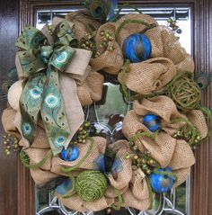 Deco Mesh BURLAP MOSS and PEACOCK Feathers by decoglitz on Etsy. Need this. It would look great on my new blue door ;)