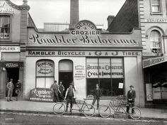 """Auckland, New Zealand, 1902. """"Dexter & Crozier, cycle importers, Victoria Street East."""" Glass negative by James Hutchings Kinnear."""