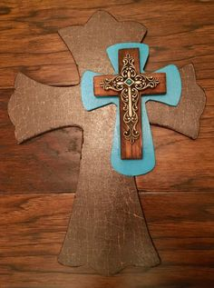 A personal favorite from my Etsy shop https://www.etsy.com/listing/472305826/9-x-12-brown-and-turquoise-wooden-cross