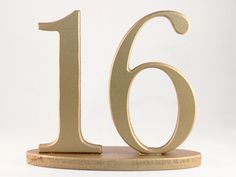 Gold Wedding Table Numbers - Metallic, Wooden for Reception Centerpieces. $200.00, via Etsy.