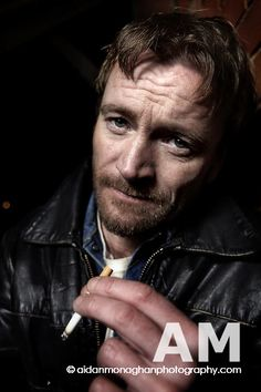 Richard Dormer smoking a cigarette (or weed)