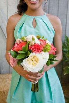 Coral and Teal Wedding Colors I absolutely love the dress. So modest yet beautiful.