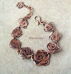 Copper Bracelet \ made of copper wire made by hand possible to produce to order Hammered spiraled wire roses with s clasp