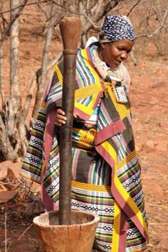 Elderly woman wearing Venda blankets made from local nwenda cloth - Game lodge cultural area