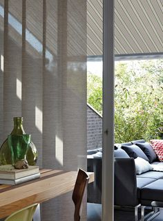 Due to the way bi-fold doors open, blinds that open and close horizontally can prove problematic. Installing Luxaflex® vertical blinds for bi-fold doors means you can slide them completely out of the way when your windows are pushed all the way back, allowing for flow between internal and external spaces. If you want something in between completely closed or open, you can tilt the panels for gradual changes in natural lighting.