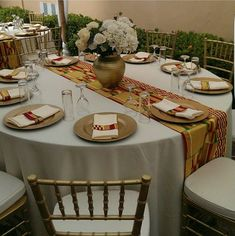 Afrocentric African inspired table setting, event table scape.  #africanprintfabric #africantablescape