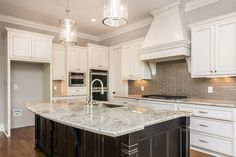 Traditional Kitchen with 30 in. Gas Cooktop in Stainless Steel with 5 Burners including EZ-2-Lift Hinged Grates, Custom hood