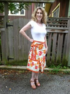 This could not be easier, just 2 rectangles with ties. I used coordinating fabrics, not a border print to create the skirt.