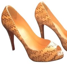 Peep-toe Python Heels Pre-loved, gently used and 100% authentic Louboutin Python heels. Wrapped platform, cream and brown in original box with dust bag. Please note that the shoes are marked Size 40 (US 10) but they run small and fit like a US 9. Christian Louboutin Shoes Heels