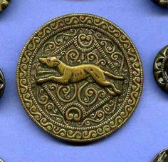 Early brass relief button with hound