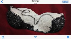 Handmade porcelaine clay bra  by Eunice Jardim with white, black frits...
