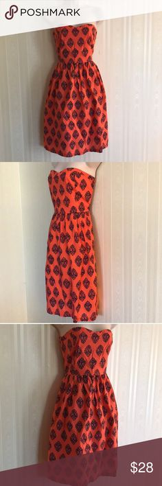 OLD NAVY print dress NEVER WORN Gorgeous and trendy, this patterned dress is a showstopper.  Orange and navy blue.  Excellent condition.  Outer dress and liner are both 100% cotton.  Side zip with elastic panel on back to add stretch if needed for the perfect fit.  Don't miss! Old Navy Dresses Strapless