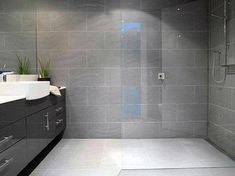Grey Bathroom Wall Tile Ideas With Curbless Walk In Shower Grey Bathroom Wall Tiles, Light Grey Bathrooms, Gray Shower Tile, Dark Gray Bathroom, Gray Bathroom Decor, Bathroom Interior Design, Bathroom Flooring, Small Bathroom, Bathroom Ideas