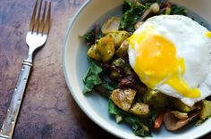 Chard and cashew pesto-covered roasted potatoes with a healthy helping of wilted greens, topped with an egg.
