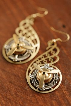 Wow, just wow is the only way to describe these unique chandelier style earrings with spinning Propellers, Compass and Filigree Wings. Featuring working propellers, compass dials and brass filigree wi