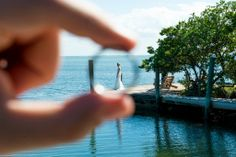 Bride/groom picture taken through our rings! Photo taken by Caterson Media caterson.com at Coconut Cove Resort in Islamorada, FL
