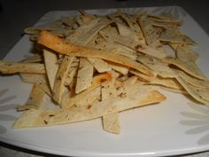 Here is Seleide Cs recipe for tortilla crisps.  Ingredients:  8-10 small tortillas 3 tablespoons olive oil 3 tablespoons parmesan cheese, grated 1 tablespoon oregano Salt and black pepper   Directions:  1.	Cut tortillas into ½-inch strips; place all strips in large bowl. 2.	Add remaining ingredients and mix well.  3.	Place strips on 4-inch rack and cook for 5 minutes on Power Level HI 4.	Turn the crisps and cook for additional 3 minutes on Power Level HI.