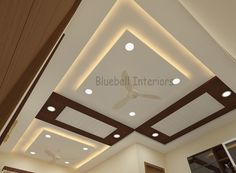 wooden ceiling arranged in such a way that it make a pattern in L shape hall. Completed with LED & concealed lights