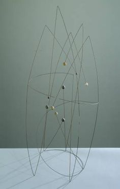 'Space Construction with a Spiral' (1950) by English sculptor & painter Robert Adams (1917-1984). Steel wire & wood, 940 x 420 x 410 mm. via the Tate
