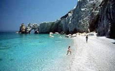 Lalaria, Skiathos . . . Accessible only by boat, I drug home bag of HEAVY white rocks from this gorgeous beach!  Fabulous honeymoon memories!