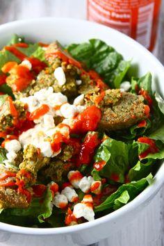 jenna's favorite salad — topped with crumbled veggie burger, feta, white balsamic vinegar, sriracha & tahini.