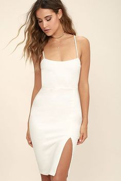 The Don't Let Me Down White Bodycon Dress will always be there for all your party needs! Medium-weight stretch knit shapes a square neckline and spaghetti straps. Darted bodice tops a sleek bodycon skirt with a sexy side slit.