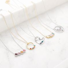 There is always something special about adding a birthstone piece to your collection. With so many options in stone count - metal color. We have it. #jewelry #birthstone #necklace Birthstone Pendant, Birthstone Charms, Birthstone Necklace, Family Tree Necklace, Gold Locket, Stone Gold, Bar Necklace, Birthstones, Count