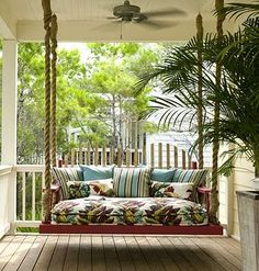 Pretty Porch Swing Bed at http://staleymc.blogspot.com/2010/06/pretty-porches.html  #swing #bed #porch #garden #outdoor #decor