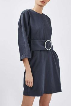 Dress up a simple silhouette in this belted dress by Boutique. Crafted in a rich cotton, we love the exaggerated dome sleeves, and oversized '80s inspired belt - detailed with a metal ring. Throw it on with mules for a trending feel. #Topshop