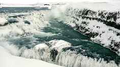 https://flic.kr/p/KpDoR8 | Gullfoss waterfall in semi-frozen motion | Gullfoss waterfall in Southwest Iceland on a bitterly cold winter's day. Part of its stream were frozen while the sheer amount and power of the water coming down the river keeps other parts open and running.  PX500 | BR-Creative | chbustos.com