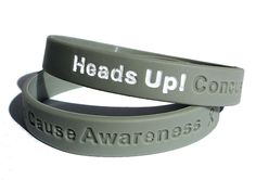 Concussions are finally getting the attention they deserve - help make a difference with this SupportStore-designed awareness wristband.Buy our Heads Up!  Concussion Cause Awareness Grey Rubber Bracelet Wristband for parents and team members to wear as a reminder.The white-filled letters Heads Up! stands out as a visible reminder to play safe. The Concussion Cause Awareness text promotes the awareness that brain injuries must be taken seriously and treated patiently.High school and college…