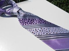 This tie has GOT to be the most blinged one in the shop! This tie has pattern of Purple and Lavender stripes. There are even small accent stripes of midnight blue woven into this tie. This tie will go great with any suit you have! Not only will this tie bring life to a neutral khaki of grey suit, but try this under a white or even a blue daycoat for an extra eye-catching surprise.  #Swarovski #rhinestones #Crystals #bling #saddleseat #English  #horseshow #ridingapparel  $52.00, via Etsy.