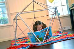 Homemade newspaper play structures by Inner Child Fun